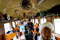 An armed Thai policeman holds his weapon among passengers on the train he secures between troubled Yala and Pattani provinces in southern Thailand March 30, 2010. Separatists are blamed for most of the attacks on Thailand's predominantly Muslim deep south, which often target Buddhists and Muslims associated with the Thai state, such as police, soldiers, government officials and teachers. No credible group has claimed responsibility for near daily drive-by shootings and bombings, which continue unabated, despite a massive counterinsurgency effort. The government has sought to tackle the unrest with a five-year $1.9 billion stimulus to reduce economic disparity and minimise the influence of insurgents, but many locals believe the measures will be futile. REUTERS/Damir Sagolj (THAILAND)