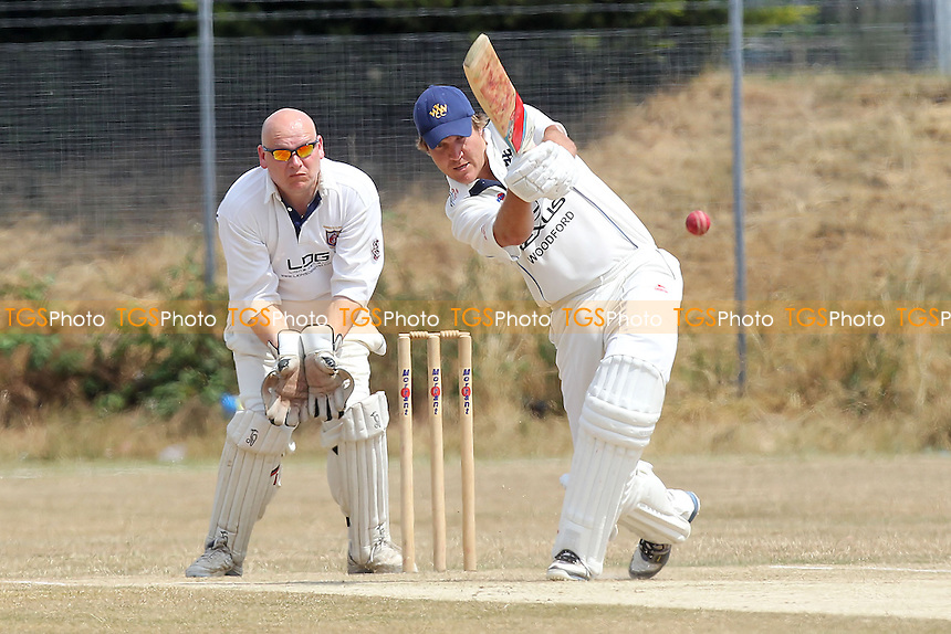 A Baars in batting action for Woodford Wells as J French looks on from behind the stumps - Hainault & Clayhall CC vs Woodford Wells CC - Essex Cricket League - 13/07/13 - MANDATORY CREDIT: Gavin Ellis/TGSPHOTO - Self billing applies where appropriate - 0845 094 6026 - contact@tgsphoto.co.uk - NO UNPAID USE