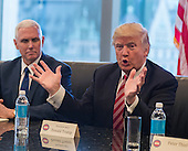 United States President-elect Donald Trump is seen at a meeting of technology leaders in the Trump Organization conference room at Trump Tower in New York, NY, USA on December 14, 2016. US Vice President-elect Mike Pence looks on from left.<br /> Credit: Albin Lohr-Jones / Pool via CNP