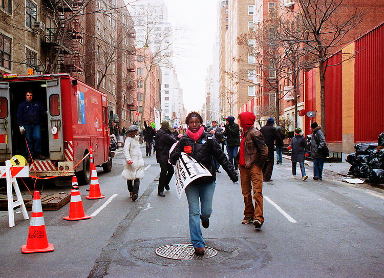 "An estimated 300,000 people took to the streets of New York City on February 15, 2003 to protest the impending U.S. led invasion of Iraq.<br /> <br /> Protests were held worldwide in what turned out to be the largest coordinated ant-war protest in history, with an estimated 6-20 million people demonstrating in 800 cities across the world that day.<br /> <br /> The conception of the mass protest is attributed to several ""anti-globalist"" European organizations, and was taken up swiftly in the United States, most notably by the ""United for Peace and Justice"" organization.  While the most heavily attended protests occurred in Europe (with some 3 million people flocking to the streets of Rome and 1 million in London) protests in the United States were well attended also.  In New York City the day was marked with a heavy police presence as people were penned in by various barricades from block to block, not allowing the vast majority of them to reach the final protest staging area and effectively cutting the huge crowd off from itself.  There were also many reports of police abuse and unnecessary arrests.<br /> <br /> Although the coordination and scope of the protests was unprecedented, the response of the US government was underwhelming and ultimately demoralizing to the movement- on March 20, 2003, the invasion of Iraq began.  From that point, mass protests attracted fewer and fewer people as many felt that their voices were indeed being heard but ultimately ignored."