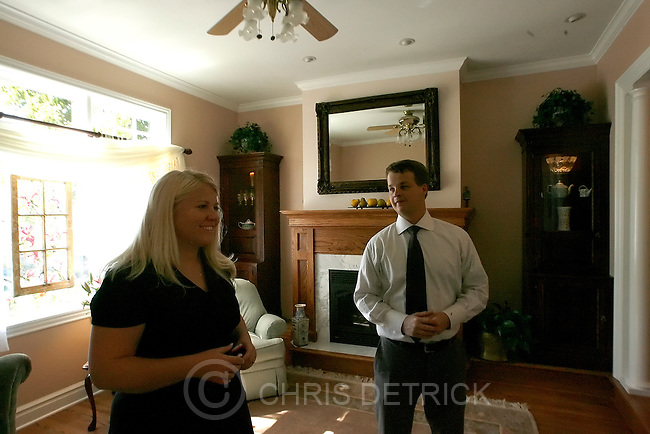 Real estate agent Adam Kirkham shows Olivia Bramble a home for sale at 1037 E 2nd Ave Wednesday, September 24, 2008. Bramble is in the market for buying a home. .Chris Detrick/The Salt Lake Tribune.