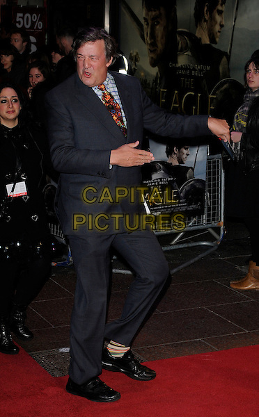 "STEPHEN FRY .At the UK Film Premiere of ""The Eagle"", Empire Leicester Square, London, England, UK, March 9th 2011..full length grey gray suit print orange tie hands gesture hand back shoes .CAP/CAN.©Can Nguyen/Capital Pictures."