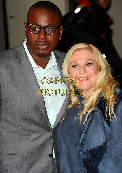 "BEN OFOEDU & VANESSA FELTZ .Attending the Press Night for the new musical stage production of the ""Wizard of Oz"", London Palladium, London, .England, UK, March 1st, 2011..half length grey gray suit glasses white shirt couple blue shirt .CAP/CJ.©Chris Joseph/Capital Pictures."