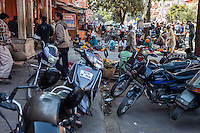 Jaipur, Rajasthan, India.  Motor Bikes and Flower Vendors outside the Entrance to a Hindu Temple.