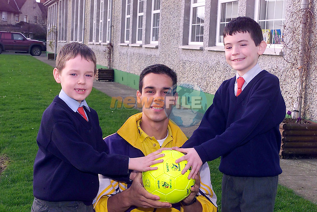 Brendan carey and james carolan with Edoard Enrici from the Samba Soccer school ..Picture Fran Caffrey Newsfile.