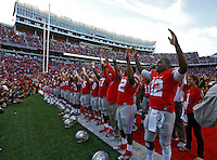 Ohio State Buckeyes quarterback Cardale Jones (12) and the Buckeyes sing Carmen Ohio after beating Hawaii Warriors 38-0 at Ohio Stadium on September 12, 2015.  (Dispatch photo by Kyle Robertson)