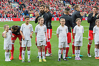 Gareth Bale of Wales chats with his mascot after the national anthems ahead of the FIFA World Cup Qualifier match between Wales and Georgia at the Cardiff City Stadium, Cardiff, Wales on 9 October 2016. Photo by Mark  Hawkins / PRiME Media Images.