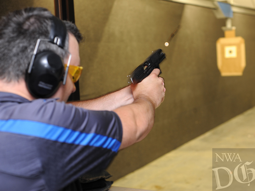 NWA Democrat-Gazette/ANDY SHUPE<br /> Everett Deger, marketing director for Walther Firearms in Fort Smith, demonstrates Wednesday, Aug. 26, 2015, the new PPQ 45, a .45-caliber pistol the longtime German gunmaker has designed for the American market.