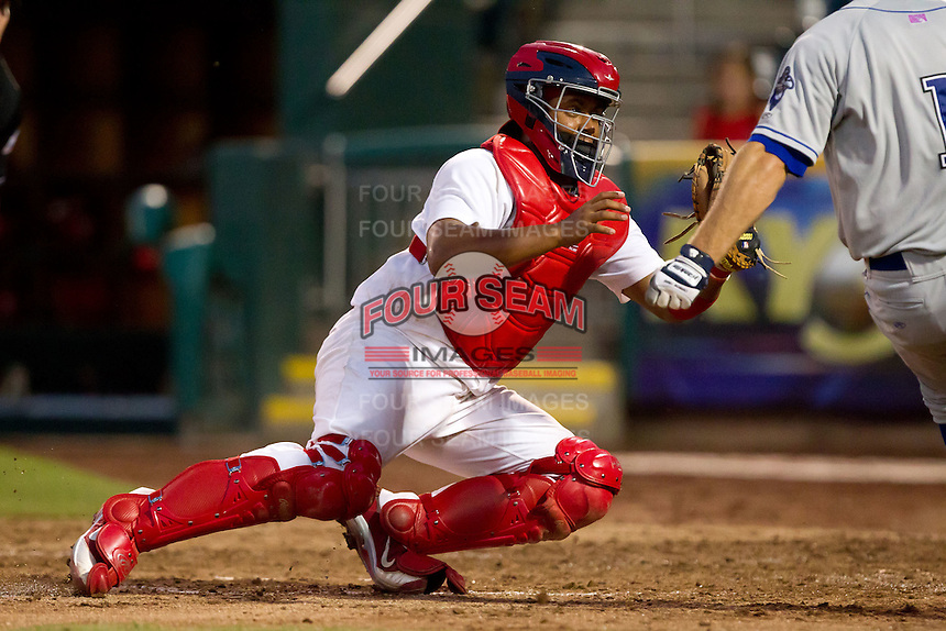 Audry Perez (10) of the Springfield Cardinals tags Erik Wetzel (1) of the Tulsa Drillers out at home plate during a game against the Tulsa Drillers at Hammons Field on July 19, 2011 in Springfield, Missouri. Tulsa defeated Springfield 17-11. (David Welker / Four Seam Images)