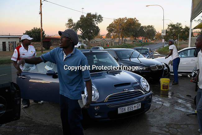 Men wash cars at a carwash in Jabulani, Soweto.