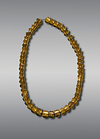 Bronze Age Hattian gold necklace from Grave L,  possibly a Bronze Age Royal grave (2500 BC to 2250 BC) - Alacahoyuk - Museum of Anatolian Civilisations, Ankara, Turkey. Against a gray background