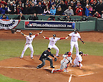 BOSTON, MA - OCTOBER 30 : Jonny Gomes  of the Boston Red Sox slides safely into home plate as teammates make call against the St. Louis Cardinals on October 30,2013 in game six of the World Series at Fenway Park. (Photo by Steve Babineau/Boston Red Sox)