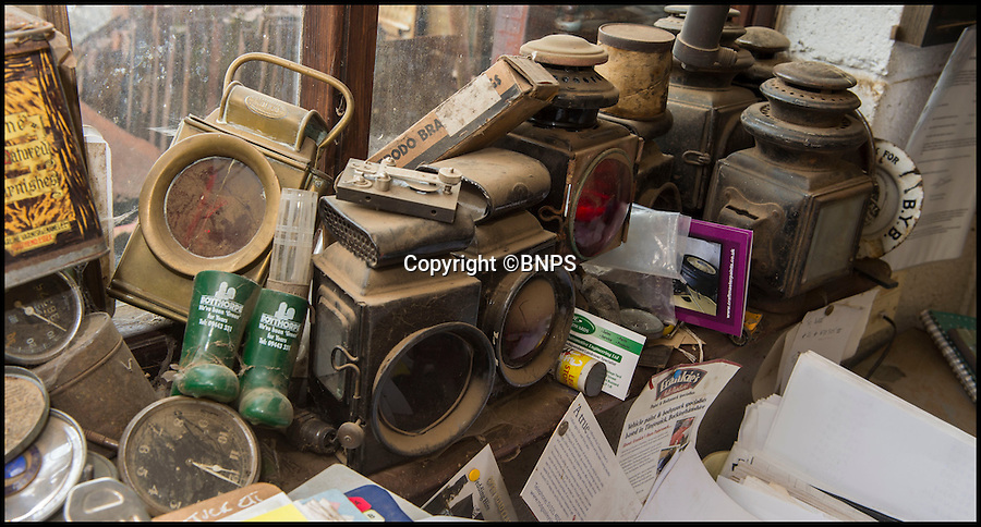 BNPS.co.uk (01202 558833)<br /> Pic: PhilYeomans/BNPS<br /> <br /> Plenty of spares in Neil's 'showroom'<br /> <br /> Garage that time forgot...<br /> <br /> Business is booming at Neil Tuckets time warp garage in the heart of Buckinghamshire - Where you can by any car…as long as its a Model T Ford.<br /> <br /> Despite his newest models being nearly 90 years old, Neil struggles to keep up with demand with customers snapping up one a week, despite their rudimentary levels of comfort and trim.<br /> <br /> Neil sources his spares from all over the globe and carefully puts the machines back together again.<br /> <br /> 'There like a giant meccano set really, and so beautifully simple and reliable they just won't let you down...You also don't require road tax or and MOT!'