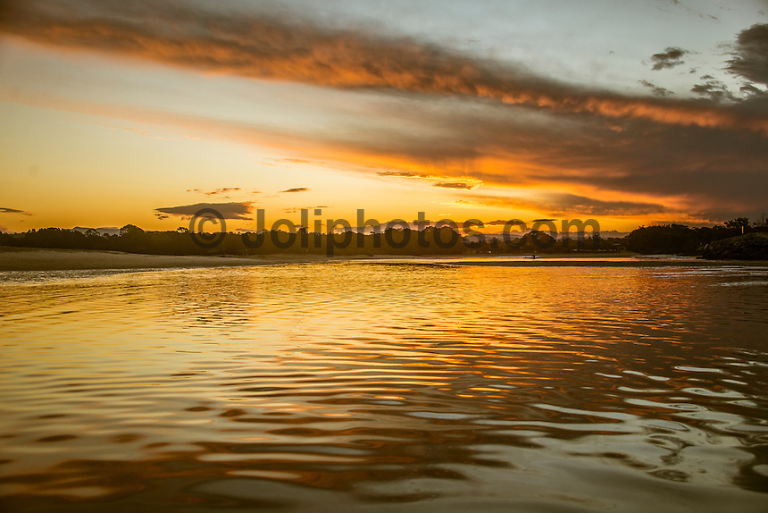 Currumbin, Queensland Australia. (Thursday October 1, 2015) – Sunset over Currumbin Creek with the edge of a spring thunderstorm slipping away to the north. Photo: joliphotos.com