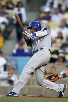 Starlin Castro #13 of the Chicago Cubs bats against the Los Angeles Dodgers at Dodger Stadium in Los Angeles, California on May 3, 2011. Photo by Larry Goren/Four Seam Images