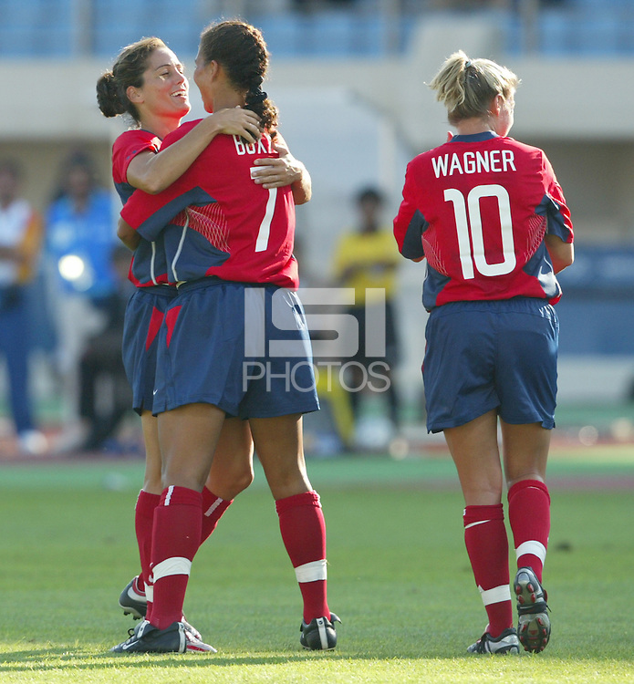 August 11th, 2004:  Julie Foudy celebrates with Shannon Box after Box scored a goal during the first half of the game against Greece at Pankritio Stadium in Heraklio, Greece.  USA defeated Greece, 3-1..Credit: Michael Pimentel / ISI