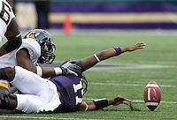 Cecil Whiteside of California sacks Washington quarterback Keith Price causes him to fumble the ball during the game at Seattle, Washington on September 24th, 2011.  Washington defeated California 31-23.