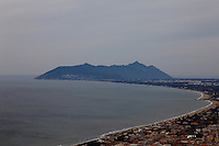 On the top of the high ground where are the ruins of the ancient Giove temple in Terracina, looking towards sud: the gulf within Terracina and San Felice Circeo, overlooked by the Monte Circeo itself, with the profile of the Circe sorceress against the cloudy wintry sky. Digitally Improved Photo.