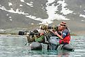 Tourists / photographers photographing polar bears. Woodfjorden, northern Spitsbergen, Svalbard, Arctic Norway.