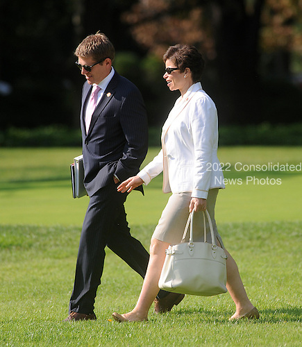Senior Advisor Valerie Jarrett and Press Secretary Jay Carney walk toward Marine One as President Barack Obama leaves the White House on September, 27, 2012 in Washington, D.C . The President will attend a campaign event  in Virginia Beach, Virginia..Credit: Olivier Douliery / Pool via CNP