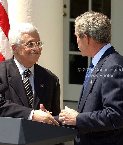 United States President George W. Bush and Prime Minister Mahmoud Abbas of the Palestinian Authority shake hands after their Oval Office meeting as they met reporters in the Rose Garden at the White House in Washington, DC on July 25, 2003 before retiring to lunch in the Residence..Credit: Ron Sachs / CNP