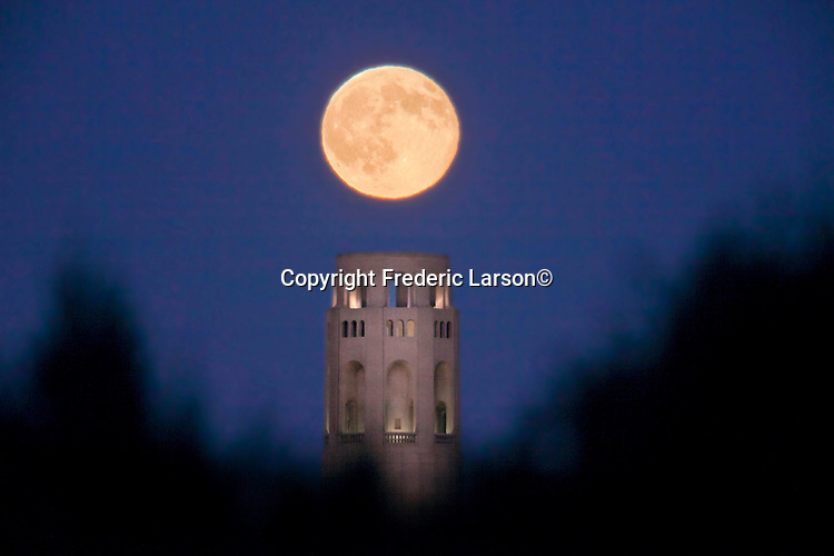 The full moon settles near the top of San Francisco's landmark Coit Tower on the first day of Autumn 09/23/10.