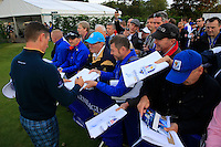 Justin Rose (EUR) signing autography after the Team pictures ahead of the 2014 Ryder Cup at Gleneagles. The 40th Ryder Cup is being played over the PGA Centenary Course at The Gleneagles Hotel, Perthshire from 26th to 28th September 2014.: Picture Fran Caffrey, www.golffile.ie: 23-Sep-14