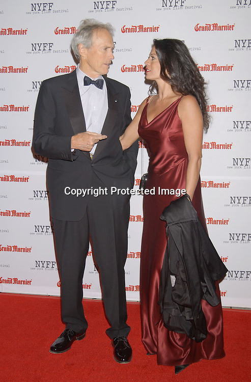 "..Clint Eastwood and wife Dina..arriving at the opening of the 41st New York Film Festival ..screening of "" Mystic River"" on October 3, 2003 in New York City. Photo By Robin Platzer, Twin Images"