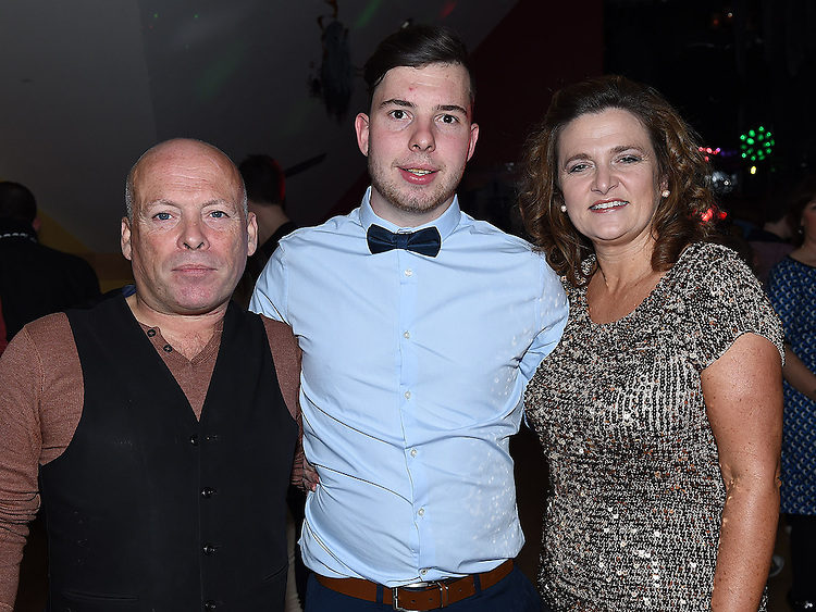 Dean Maguire celebrating his 21st birthday in the Thatch with godparents Sharon Curran and Dermot Wearenl. Photo:Colin Bell/pressphotos.ie