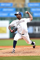 NW Arkansas Naturals pitcher Noel Arguelles (45) delivers a pitch during a game against the Corpus Christi Hooks on May 26, 2014 at Arvest Ballpark in Springdale, Arkansas.  NW Arkansas defeated Corpus Christi 5-3.  (Mike Janes/Four Seam Images)