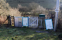 The gate and timetable at Sugar Loaf railway station, the most remote station on the Heart of Wales Line, situated by the A483 road, Powys, Wales, UK. Friday 01 December 2017
