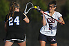 Sophia DeRosa #5 of Cold Spring Harbor, right, and Hannah Lewis #24 of Long Beach battle for possession of a faceoff during a Nassau County varsity girls lacrosse game at Cold Spring Harbor High School on Wednesday, April 18, 2018. DeRosa tallied five goals and three assists in Cold Spring Harbor's 13-2 win.
