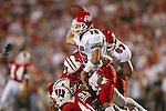 University of Wisconsin defense swarms Fresno State quarterback (15) Jeff Grady during the Fresno State game at Camp Randall Stadium in Madison, WI, on 8/23/02. The Badgers beat Fresno State 23-21.  (Photo by David Stluka)