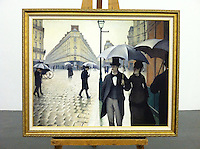 "Cleared Reproduction of Gustave Caillebotte's Paris Rainy Day Framed Dimensions 36 1/2"" x 44 1/2"" Reproduction of Paris Street; Rainy Day (or Paris: A Rainy Day) is a large (212.2cm x 276cm) 1877 oil painting by the French artist Gustave Caillebotte. The piece depicts the Place de Dublin, an intersection near the Gare Saint-Lazare, a railroad station in north Paris."