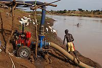 People from Duss move to Kundama Village if the pump is working so they can have a little irrigated plot of land.  The truth is, however, that pumps do not work so well in the stone age.  AK-47's work GREAT in the stone age, but pumps DO NOT.  .. Most of the time they don't have enough fuel to run the pump and if the pump breaks they have to send word to Dimeca officials and it can take about a month to get it fixed.
