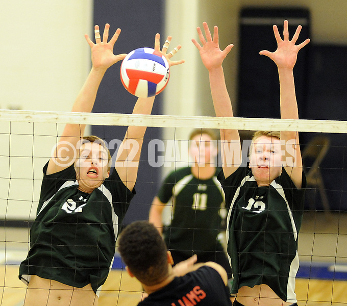 Pennridge's Aaron Nelson #27 and teammate Ben Chinnici #13 blocks a volley from Hempfield's Cole Rineer #9 during the first round PIAA state volleyball game between Hempfield and Pennridge at Quakertown High School Wednesday May 27, 2015 in Quakertown, Pennsylvania. Hemp field defeated Pennridge 3-0. (Photo by William Thomas Cain/Cain Images)