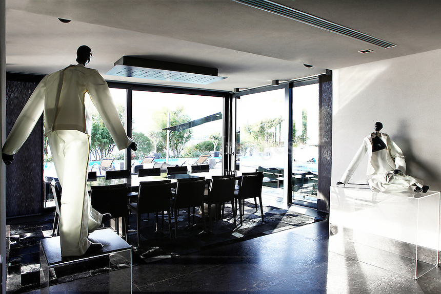 modern dining room with sculptures