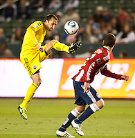 CARSON, CA – APRIL 9, 2011: Columbus Crew midfielder Dejan Rusmir (22) pass the ball during the match between Chivas USA and Columbus Crew at the Home Depot Center, April 9, 2011 in Carson, California. Final score Chivas USA 0, Columbus Crew 0.