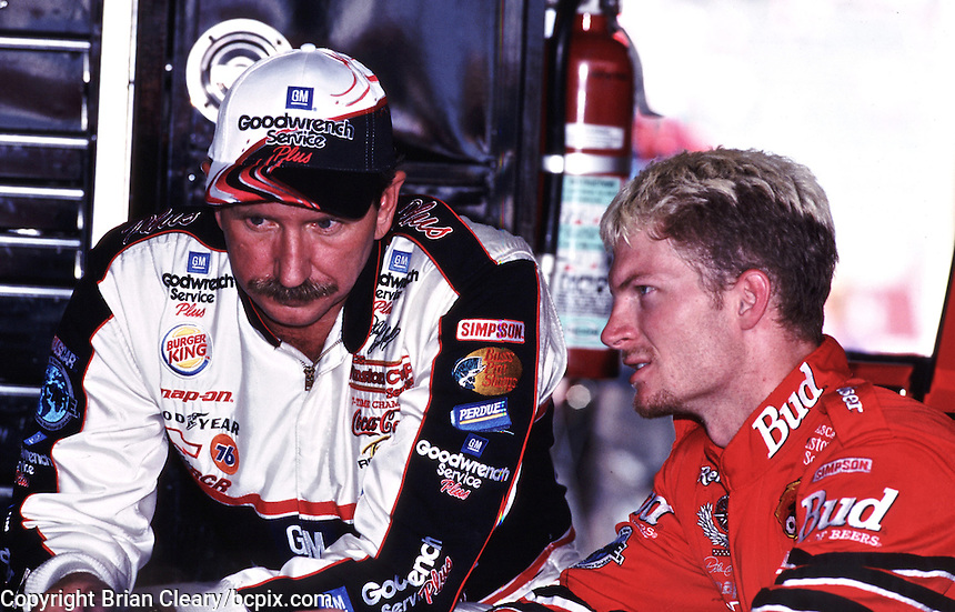 Dale Earnhardt (left) talks with his son, Dale Earnhardt, Jr. in the garage area at Darlington, SC on Friday, 9/1/00, as they prepare for the Pepsi Southern 500 NASCAR race.  (Photo by Brian Cleary)  (Photo by Brian Cleary/www.bcpix.com)
