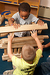 Preschool 3-4 year olds two boys workng together on block structure
