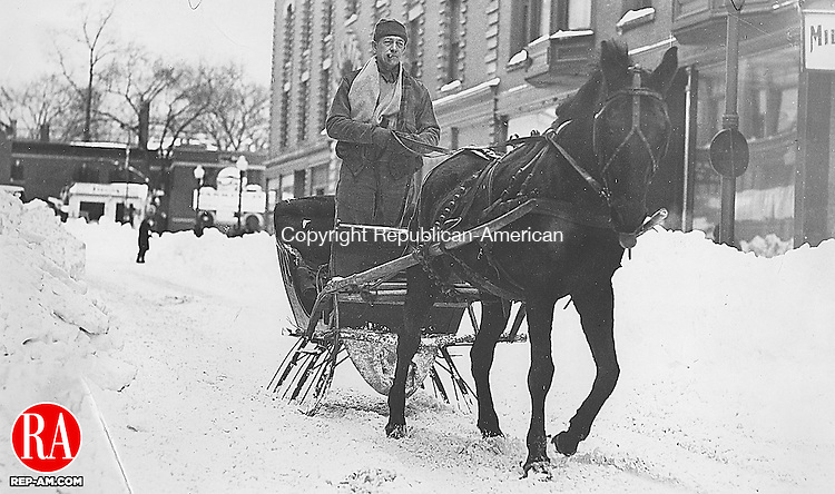 All bundled up and puffing a cigar, James J. Dillon of Waterbury traveled smoothly down Center Street on February 22, 1934, following the blizzard that paralyzed motor traffic. 22 February 1934