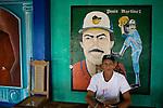 Nicaraguan man sits at entrance to the Flor de Cana baseball stadium in Granada, Nicaragua