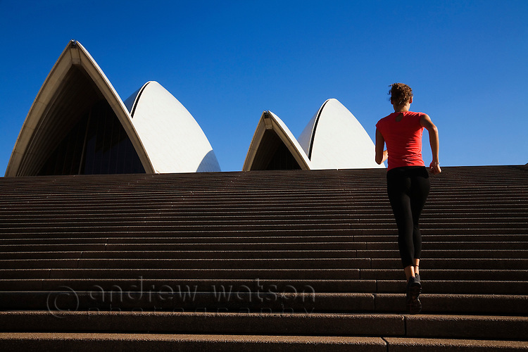A runner climbs the steps of the Sydney Opera House. Sydney, New South Wales, AUSTRALIA.