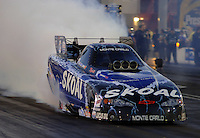 Apr 7, 2006; Las Vegas, NV, USA; NHRA Funny Car driver Tommy Johnson Jr. does a burnout in the Skoal Chevrolet Monte Carlo during qualifying for the Summitracing.com Nationals at Las Vegas Motor Speedway in Las Vegas, NV. Mandatory Credit: Mark J. Rebilas