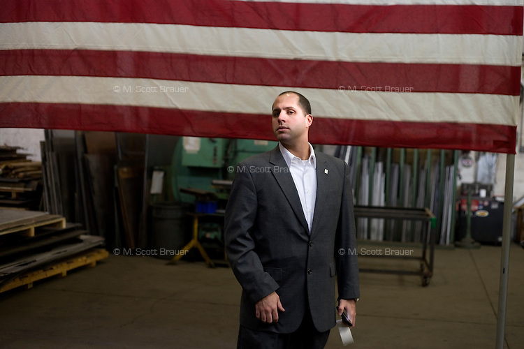 Members of Mitt Romney's security team stand at the edge of a Romney campaign event to begin at Gilchrist Metal Fabricating in Hudson, New Hampshire, on Jan. 9, 2012.  Romney is seeking the 2012 Republican presidential nomination.