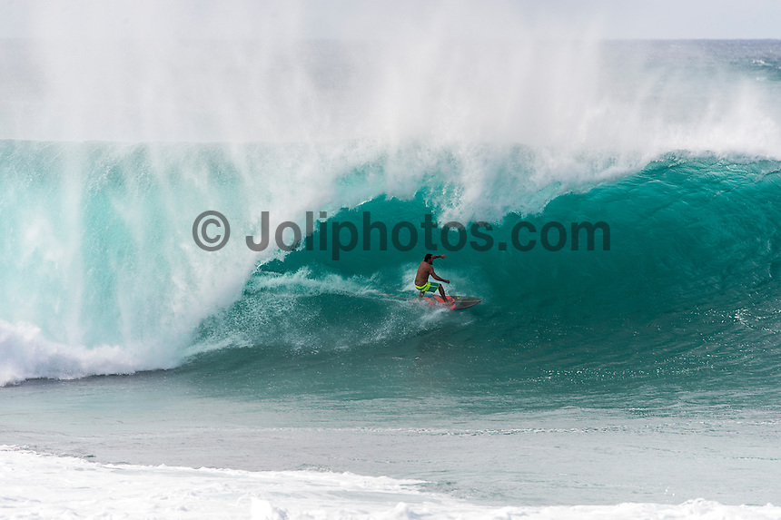 BANZAI PIPELINE, Oahu/Hawaii (Saturday, December 13, 2014) - The final stop of the 2014  World Championship Tour, the Billabong Pipe Masters in Memory of Andy Irons, was  called ON today in NW double overhead surf. <br /> Round 1 was completed as the swell continued to rise and the Easterly Trade winds increased in strength. Kelly Slater (USA) kept his World Title hopes alive after winning his heat against Reef MacIntosh (HAW). Jordy Smith(ZAF) was injured when he hit the reef at Backdoor.<br /> Conditions worsen around the end of the Round and the event was first put on hold then postponed for the day.  <br /> <br /> The Billabong Pipe Masters in Memory of Andy Irons will determine this year&rsquo;s world surfing champion as well as those who qualify for the elite tour in 2015. As the third and final stop on the Vans Triple Crown of Surfing Series  the event will also determine the winner of the revered three-event leg.<br /> <br />  Photo: joliphotos.com