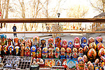 Stock photo of matreshkas russian souvenirs  Colorful set of decorative nesting dolls matreshkas standing in rows on a stall Ukraine Kiev arts and crafts