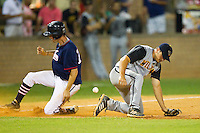 Seth Neely #5 (Wofford) of the Wilson Tobs can't handle the throw as Evan Stephens #13 (Wake Forest) of the High Point-Thomasville HiToms slides into third base at Finch Field on June 17, 2013 in Thomasville, North Carolina.  The Tobs defeated the HiToms 3-2 in 11 innings.  Brian Westerholt/Four Seam Images