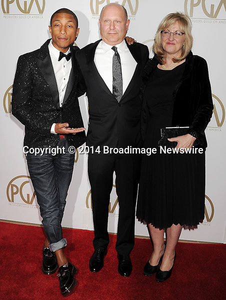 Pictured: Pharrell Williams; Christopher Meledandr; Janet Healy<br /> Mandatory Credit &copy; Joseph Gotfriedy/Broadimage<br /> 25th Annual Producers Guild Awards<br /> <br /> 1/19/14, Beverly Hills, California, United States of America<br /> <br /> Broadimage Newswire<br /> Los Angeles 1+  (310) 301-1027<br /> New York      1+  (646) 827-9134<br /> sales@broadimage.com<br /> http://www.broadimage.com
