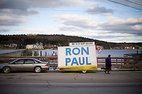 "A car pulls a trailer sign in support of Ron Paul on which is also printed the words ""Audit the Fed"" and ""Occupy Wall Street"" outside a Ron Paul town hall meeting and rally at the Church Landing at Mills Falls hotel in Meredith, New Hampshire, on Jan. 8, 2012. Paul is seeking the 2012 Republican presidential nomination."